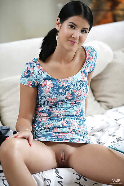 Dark haired teen girl Lady Dee takes a pee after getting into the bathtub