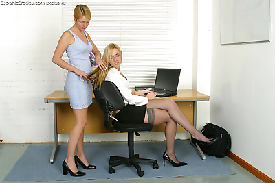 Two teenie office babes..