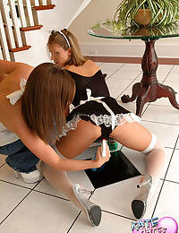 Horny brunette forces maid to undress for amateur lesbian fun in the foyer