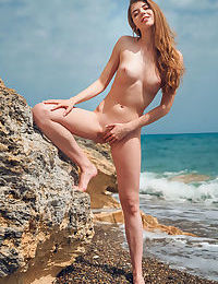 Small titted cutie Kay J sheds her bikini to frolic naked at the seashore